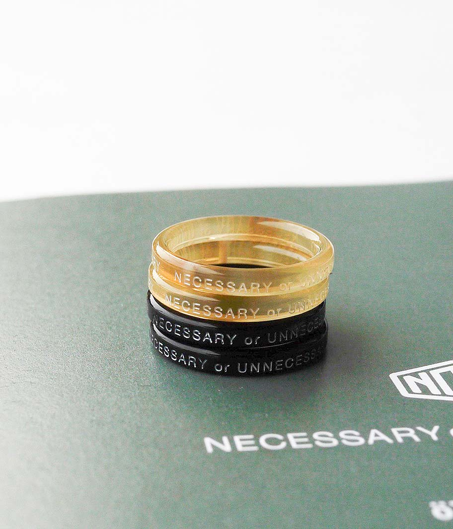 NECESSARY or UNNECESSARY BUTTON RING 2 INK